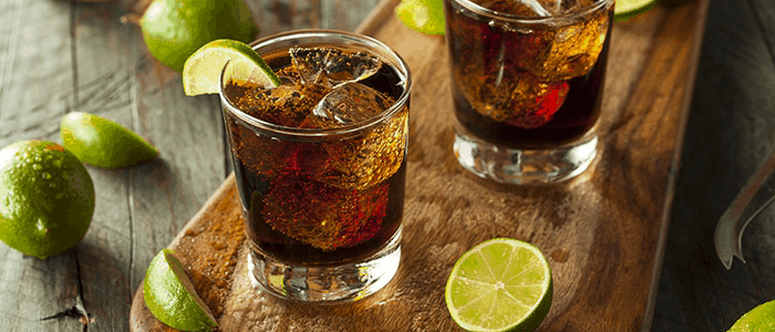 ron cola trago